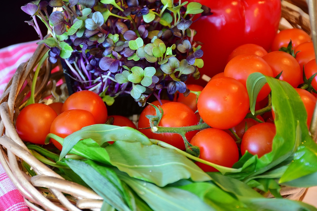 fresh vegetables and herbs in a woven basket