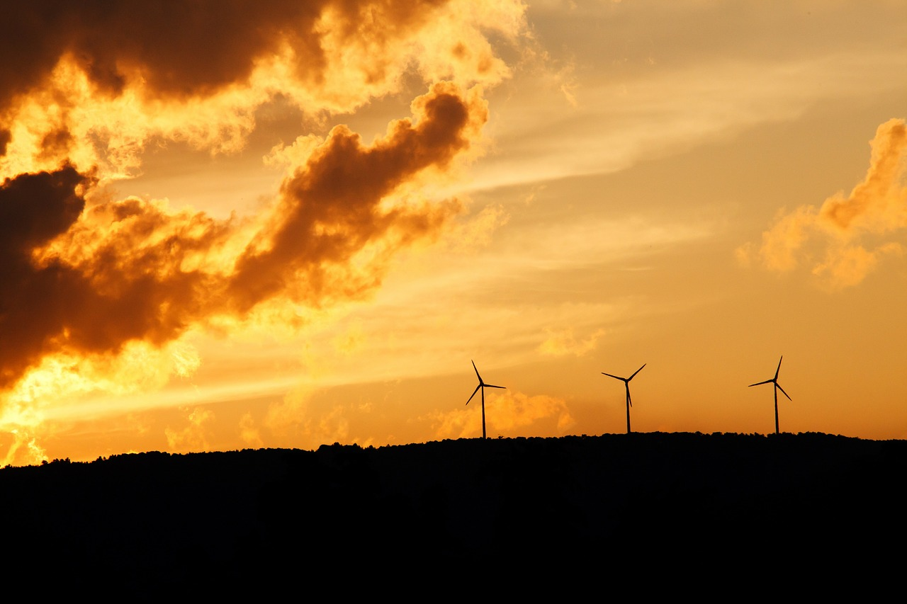 energy windmills in the sunrise