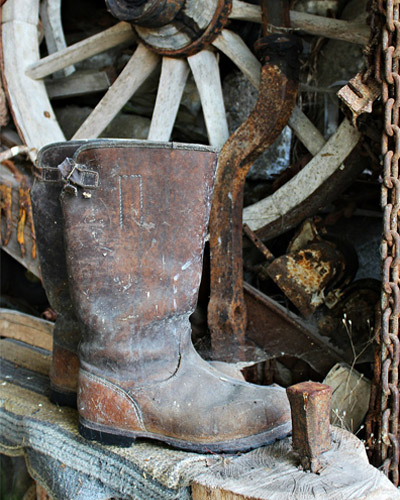 work boots and a wagon wheel well used